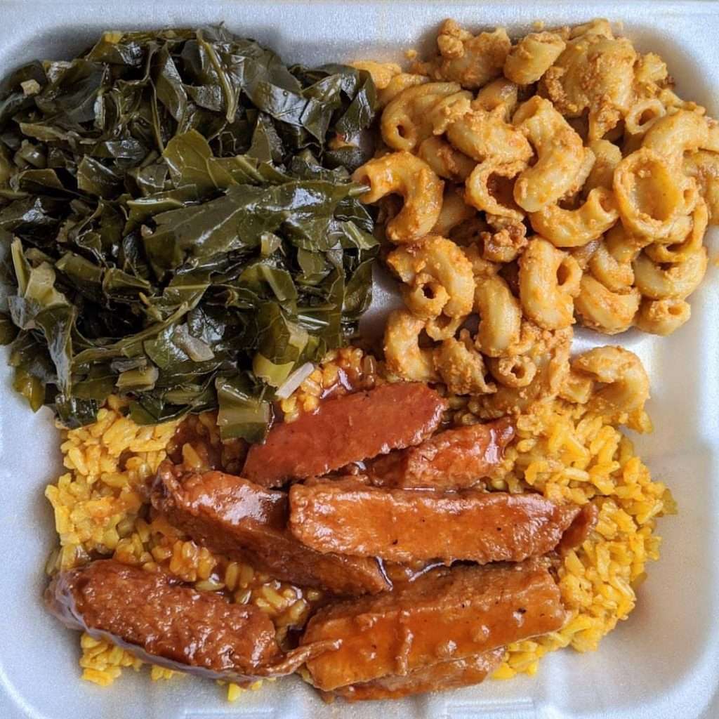 Vegan BBQ Chicken Strips on Brown Rice with a side of collard greens and plant-based mac and cheese